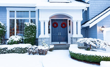 beautiful home with snow on the ground purchased with a low interest rate loan