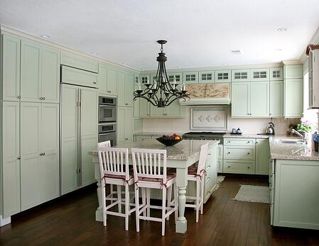 A country kitchen pistachio cabinets in a Massachusetts home.