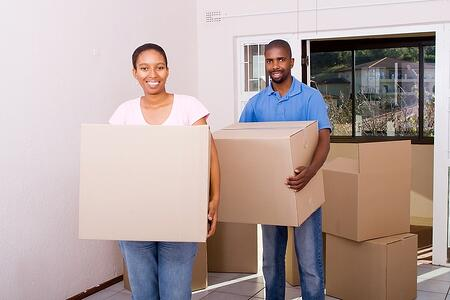 Happy homebuyers moving into their new home.