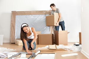 A couple moving into their Boston area home.