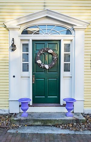 Massachusetts Home With Green Front Door With Purple Planters