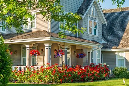 House with farmer's porch, beautiful flowers