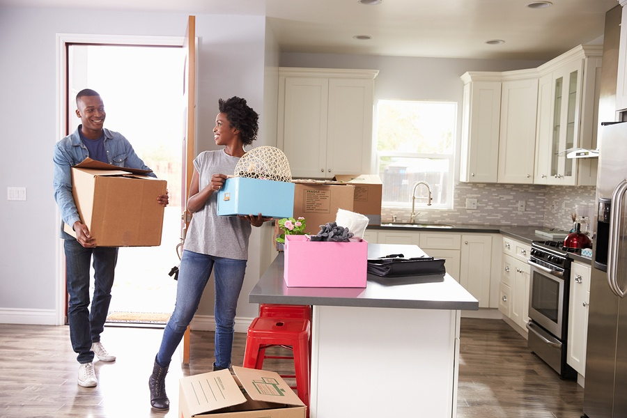 Happy homebuyers moving into their new home