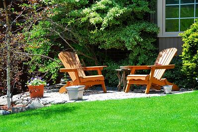 Comfortable and pleasant backyard at home with wooden chairs.