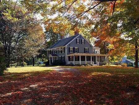 Blue Colonial-style Home with a Farmer's Porch