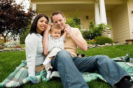 couple with a newborn at their new home.