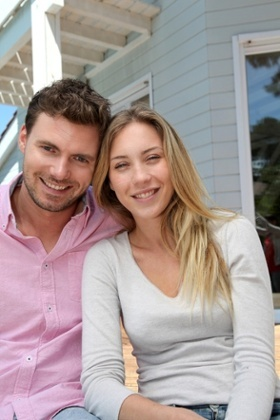Smiling Couple Who Used An Exclusive Buyer Agent to Purchase Their Massachusetts Home