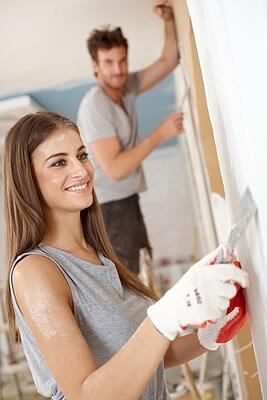 woman-renovating-man-in-background