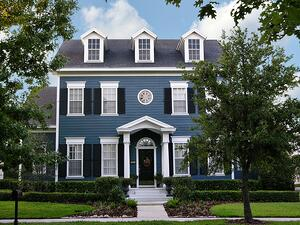 two-story blue colonial home